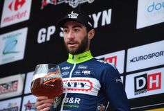 Maybe just the one - 2017 Le Samyn winner Guillaume Van Keirsbulck enjoys a beverage on the podium