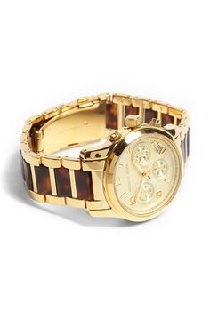 Emma's watch. She'd wear it with a matching gold stud bracelet, or some other kind of chunky bracelet. Emma has a thing for expensive watches.