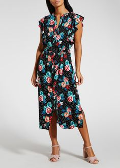With a nod to yesteryear, vintage inspired florals are in full bloom this season. Constructed in soft viscose for a comfortable fit and feel, style notes include a black base fashioned with an all-over spot and floral print. Cut in a floaty midi length, additional features include frill cap sleeves, alongside...