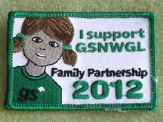 Girl Scouts Northwestern Great Lakes 100th anniversary patch.  Family Partnership patch 2012