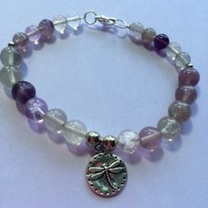 """Fluorite Beaded Bracelet Fluorite Beaded Bracelet with a small dragonfly charm Bracelet is small 7 1/2"""" long Handmade Jewelry Bracelets"""