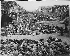 Rows of bodies of dead inmates fill the yard of Lager Nordhausen, a Gestapo concentration camp. This photo shows less than half of the bodies of the several hundred inmates who died of starvation or were shot by Gestapo men. Germany, 04/12/1945