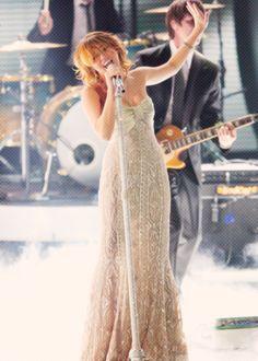 Miley Cyrus performing.