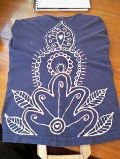 "From ""The Next Bird"" blog. Use a bleach pen to draw on a design to any dark cloth clothing items. Wouldn't this make a great yoga shirt?"