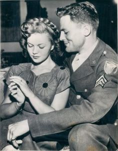 Shirley Temple and John Agar, celebrating their enagement.