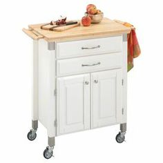 "Wood kitchen cart with castered feet. Features 2 drawers and 1 cabinet.   Product: Kitchen cartConstruction Material: Wood and metalColor: White and naturalFeatures: Ample drawer and cabinet spaceLocking casters provide mobilityClear protective lacquer Dimensions: 36"" H x 31"" W x 17.75"" DNote: Accents not included $193.00"