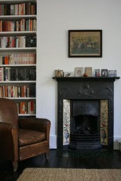 shelves, leather club chair and little black fireplace Decor, Home And Living, Apartment Living, Home Living Room, Interior, Apartment Living Room, Black Fireplace, House Interior, Fireplace