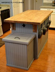 Love this kitchen island and trash can