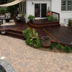 This ground level hardwood deck is just part of this little paradise very close to a busy road. The pool, firepit, grilling area and fencing all around makes this backyard a perfect site for parties. Ground Level Deck, How To Level Ground, Backyard Patio Designs, Backyard Landscaping, Yard Design, Pergola Garden, Metal Pergola, Diy Pergola, Pergola Ideas