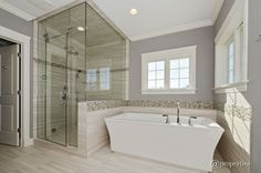 Contemporary Master Bathroom with Freestanding Bathtub, frameless showerdoor, specialty tile floors, High ceiling