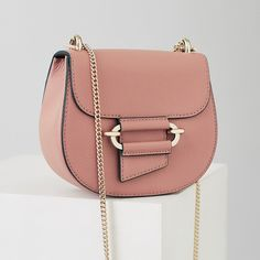 The maltby mini mini cross-body bag in plays its part in our iconic cross body collection and is available to buy online at REISS. Affiliate link