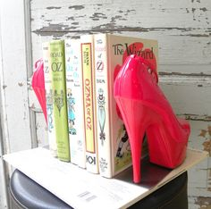 high heel bookends! I have a pair that no longer fits, post pregnancy, that would be perfect for this!