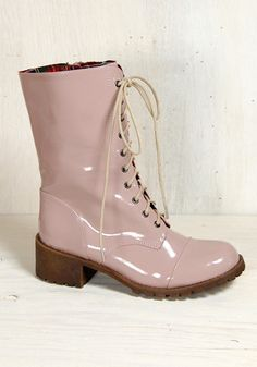 I don't really like pink or combat boots, but I can't help but think these would be perfect for a rainy spring day.