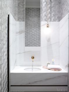 The elegant bathroom in this Regency-style home in Melbourne adds interest to muted tones through marble and textured wallpaper. From 'Silver Lining', a story on page 124 of Vogue Living September/October 2013.Photograph by Derek Swalwell.