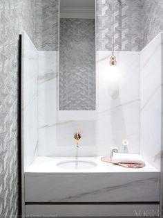 The elegant bathroom in this Regency-style home in Melbourne...