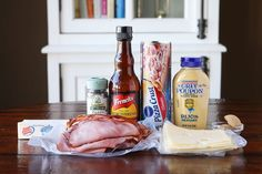 Hot Ham & Cheese Roll-Ups with a Brown Sugar Poppy Seed Glaze. Perfect for taking to friends, new moms, and family because you can assemble it the night before and bake it the next day.