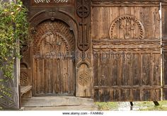 Beautiful traditional hand made door and gate from the entrance in a Romanian household - Stock Photo
