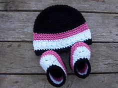 Newborn Baby Shoes and Hat by Susan Wilkes-Baker
