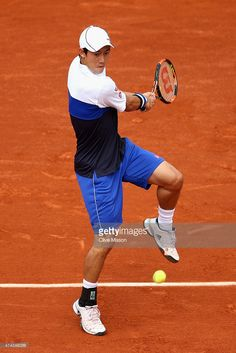 Kei Nishikori of Japan plays a backhand in his Men's Singles match against Paul-Henri Mathieu of France on day one of the 2015 French Open at Roland Garros on May 24, 2015 in Paris, France.