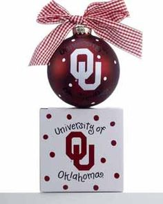 University of Oklahoma fans can show their Sooner school spirit when they hang this ornament on their tree.  The front has the school logo and on the back it says Boomer Sooner!  A red and white ribbon is tied on the top and it comes with a matching gift box.  Buy it now for $21.95 at www.ornamentshop.com