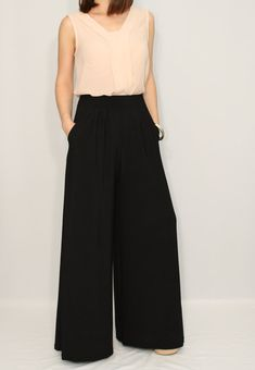 Wide leg pants with pockets in timeless Black color.  They designed with wide leg cut, elastic band for easy slip-on style and with two pockets for