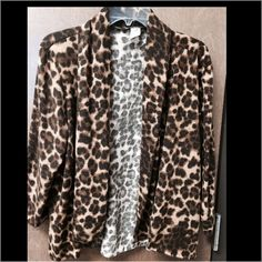 Leopard print cardigan 3/4 inch sleeves, says size 1x, but fits like a large, very good condition Sweaters Shrugs & Ponchos