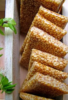 1 cup white sesame seeds ½ cup sugar 2 Tbsp honey Start with greasing two big sheets of wax paper with a bit of vegetable oil. Dry roast the sesam… Greek Sweets, Greek Desserts, Greek Recipes, Just Desserts, Indian Food Recipes, Candy Recipes, Snack Recipes, Dessert Recipes, Cooking Recipes