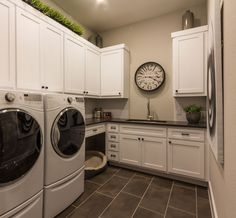 Loads of built-in white storage cabinets with sink and dog bed in this big laundry room Laundry Room Cabinets, Laundry Room Organization, Laundry Room Design, White Laundry Rooms, Modern Laundry Rooms, White Storage Cabinets, Cabinet Design, Dog Bed, Sink