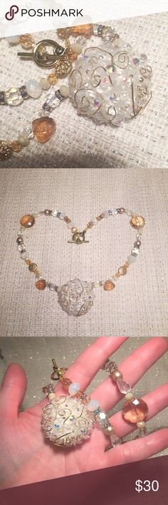 Glitterati vintage button necklace Fabulous beaded vintage button laced with 14k gold filled wire, set with AB rhinestones, glass mauve pearls,AB rhondells, glass faceted AB and peach beads. Gold plated swirl toggle clasp. Girly, sparkles and just classy gorgeous! Glintage Jewelry Necklaces