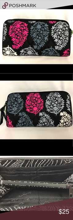 Vera Bradley Northern Lights Accordion Wallet NWT It has a gusseted interior with a coin pocket, clear ID window, and 12 card slots. It's finished with a zip around closure. This comes from a smoke free home! Vera Bradley Bags Wallets