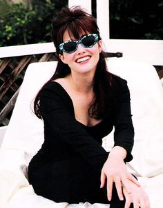 December 1991. Here, Shannon Doherty wears a pair of bedazzled cat-eye sunglasses similar to styles that are hot again for fall 2012.