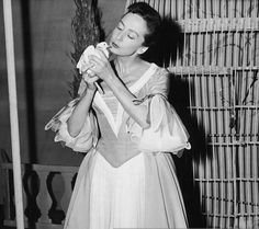 0 French actress Suzanne Flon (1918 - 2005), holding a dove