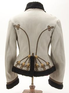 A SCARCE IMPERIAL RUSSIAN LIFE GUARD HUSSAR OFFICER'S PELLISE, CIRCA 1900. White wool jacket with black fur collar, cuffs and edging. With ornate gold cord chest, back and cuff frogging. - Jackson's International Auctioneers and Appraisers