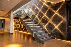 Black pearl stone veneer feature wall. Interior Lighting, Interior Ideas, Interior Design, Modern Exterior, Interior And Exterior, Gym Design, House Design, Natural Stone Cladding, Home Stairs Design