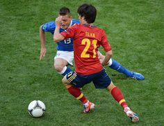Italian midfielder Emanuele Giaccherini, left, challenged Spain's David Silva for the ball