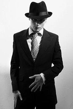 The Fedora and tailored suit scream 1920's.