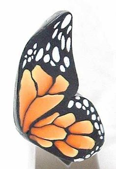Polymer clay cane 432 from 2006.  One of my better monarch butterfly wing canes.  This design has stayed in my repertoire in a number of different ways but the Monarch is a classic floral cane design.