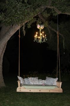 porch swing hung from a tree branch under a lighted chandelier - LOVE it!  ********************************************     (repin) - #garden #furnishings #outdoor #porch #swing #chandelier - ≈√