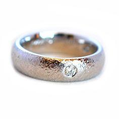Detailed custom platinum diamond men's wedding band. Custom ring by Abby Sparks Jewelry, custom jewelry designer by Denver, Colorado.