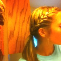 Sporty and cute. Bangs braided into ponytail.