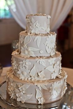 this beautiful beige floral cake matched the brides wedding dress