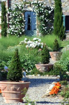 Podere Palazzo, Tuscany Italy  Love Italian pottery, than just withstand the elements better than any clay pottery