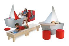 Reading Ship Children's Furniture features book boxes shaped like sailing boats that combine with benches for relaxation and reading.