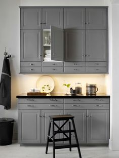 Grey wall and base cabinets with black worktop