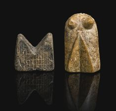 Two chess pieces, a 'Bishop' and a 'Rook', probably Nishapur, Persia, circa 12th century the tall ivory bishop of curved form with two small protrusions, the stone rook carved with two triangular angles and incised square pattern, old collection label to underside.