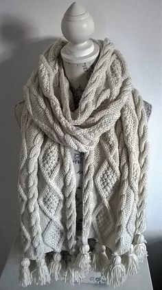 A versatile, original, designer hand knitting pattern for an Aran Cable Scarf in 3 sizes and a stunning Blanket Throw. Four knitting patterns in one.