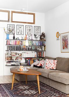 love the room. love the couch. most of all love the doll house in the bookshelf.