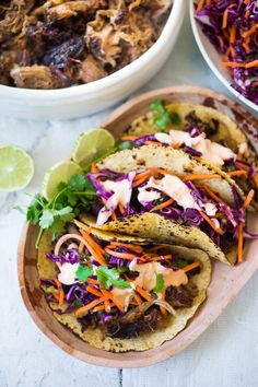 A simple flavorful recipe for Five Spice Pulled Pork Tacos with Asian Slaw and Spicy Aioli - this can be made in the oven or slow cooker. | www.feastingathome.com