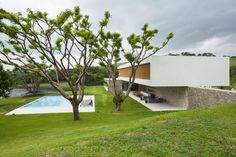 Built by RoccoVidal Perkins+Will in São Paulo, Brazil with date 2013. Images by Tuca Reinés. The house designed by the team is a composition of cubes and facades designed to fit the topography and appreciate th...