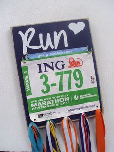race bibs holder with 5 medals hooks by runningonthewall on Etsy, $33.00. I want to make something similar.